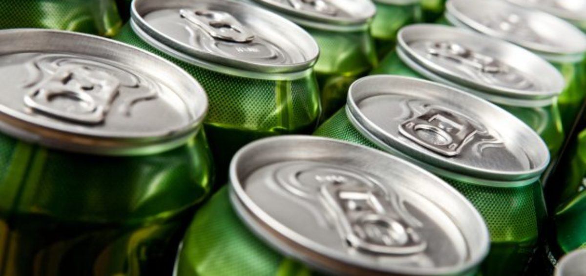 several green beer cans together in multiple lines