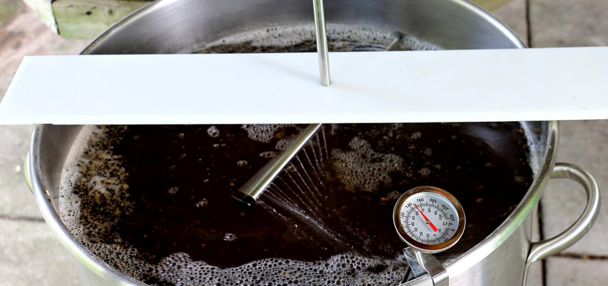 Sparging Mash for Brown Ale with sparge arm over mash tun sprinkling water