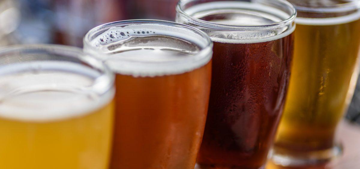 Flight of four beers in taster glasses