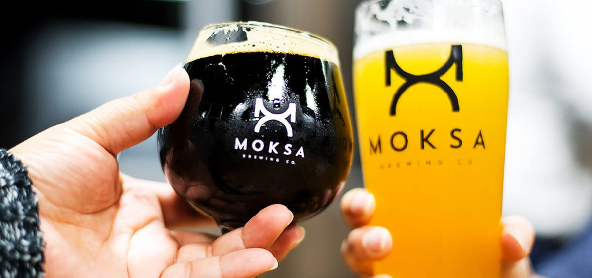 Moksa Brewing Co two glasses cheering