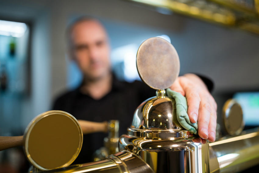 Man cleaning beer draft system