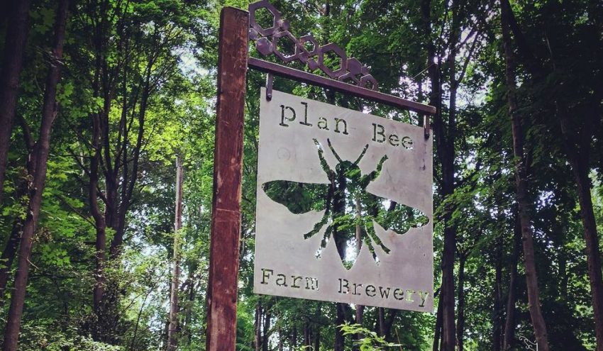 Plan Bee Farm Brewery logo sign on farm