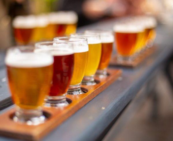 Line of beers on wooden table in a beer garden