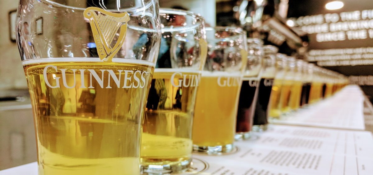 Guinness glasses lined up with Guinness Blond and Guinness Stout