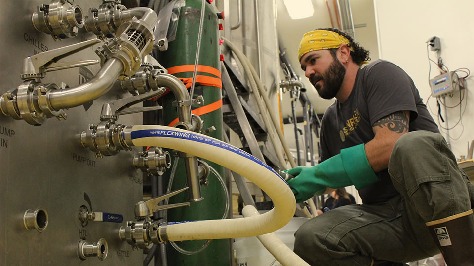 Sunriver Brewing Company's Brett Thomas working in the brewery