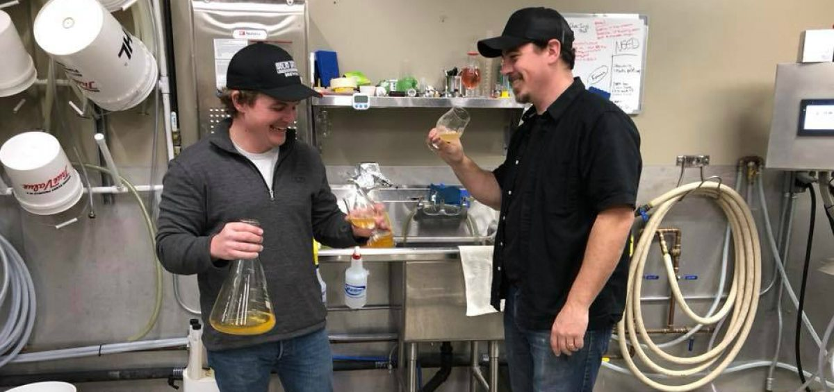 Solid Ground Brewing's KC Sare and Scott Johnson in the brewing lab