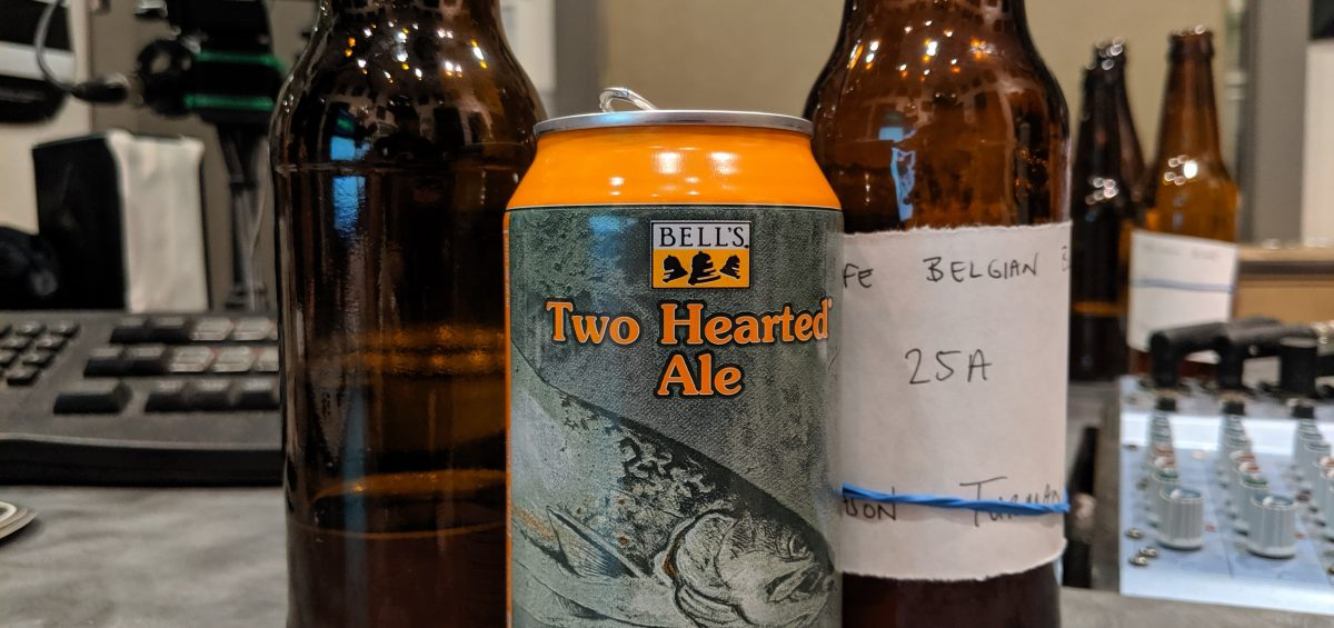 two bottles of homebrewed beer stand next to a can of Bell's Two Hearted ale on Dr. Homebrew