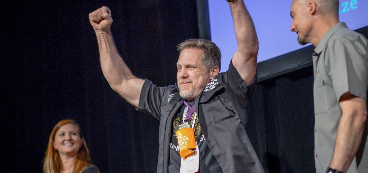 National Homebrew Competition winner with arms raised