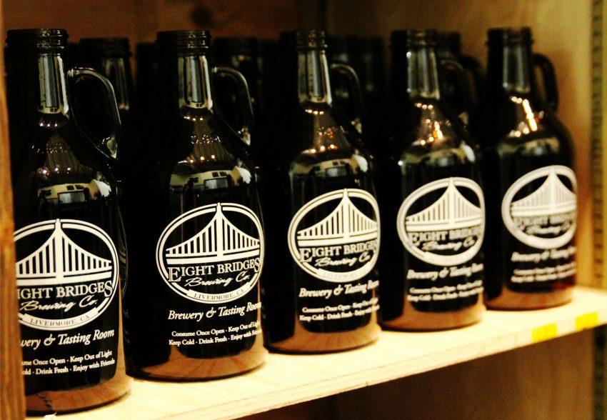 Eight Bridges Brewing Co. growlers on shelf