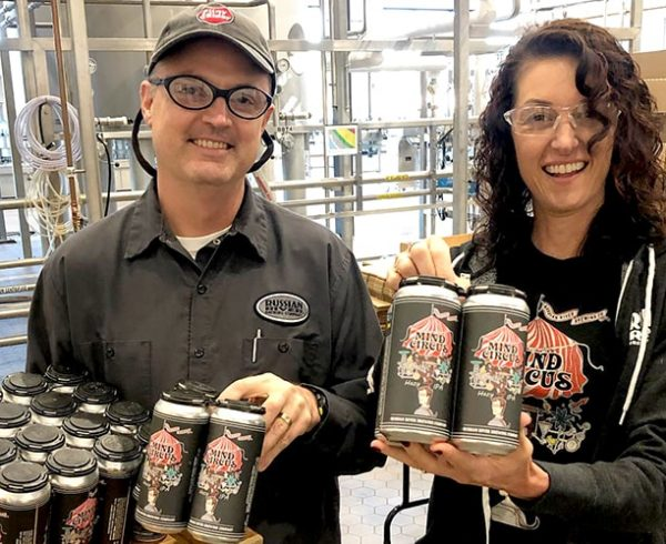 Vinnie & Natalie Cilurzo from Russian River Brewing holding cans of beer