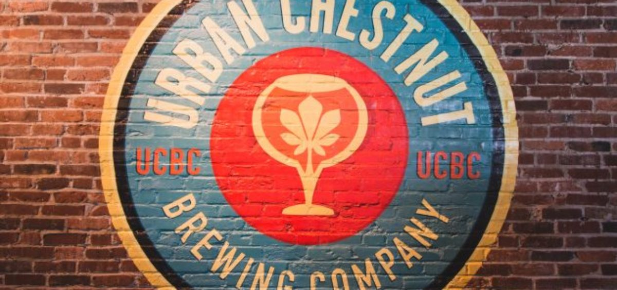 Urban Chestnut Brewing Co. logo painted on brick wall