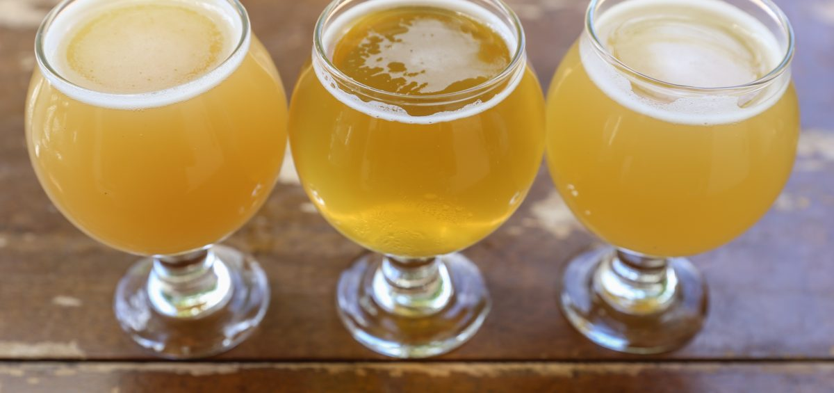 Flight of hazy and clear beers in small tulip style glasses