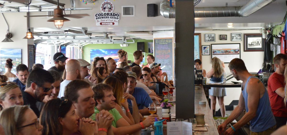 Joyride Brewing Taproom full with people at bar