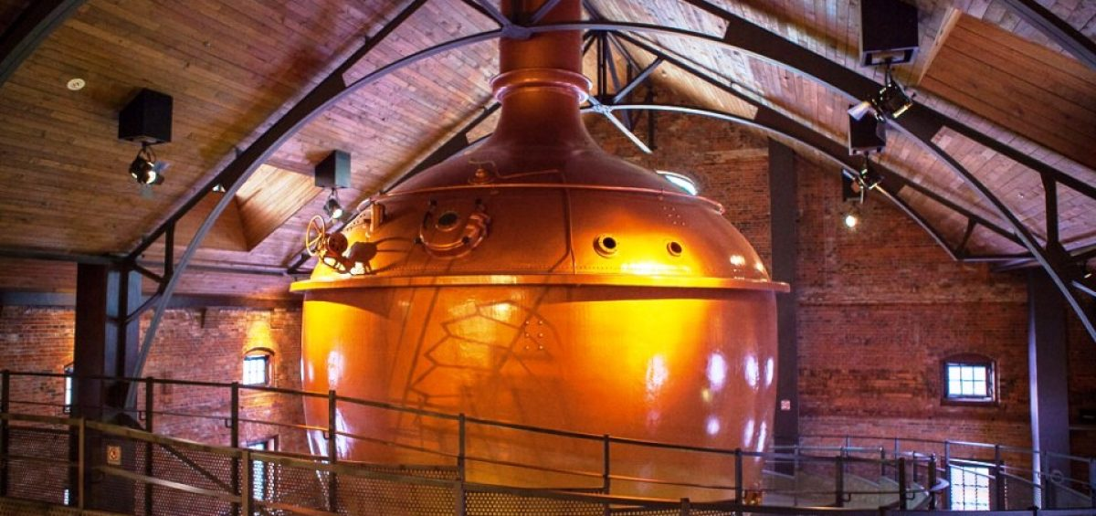 large Sapporo Brewing Company copper brewing vessel in wooden room