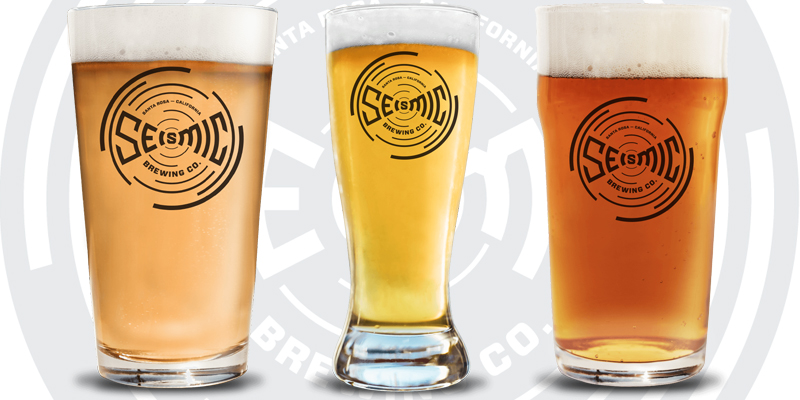 Seismic Brewing Company glasses of beer with logo in background