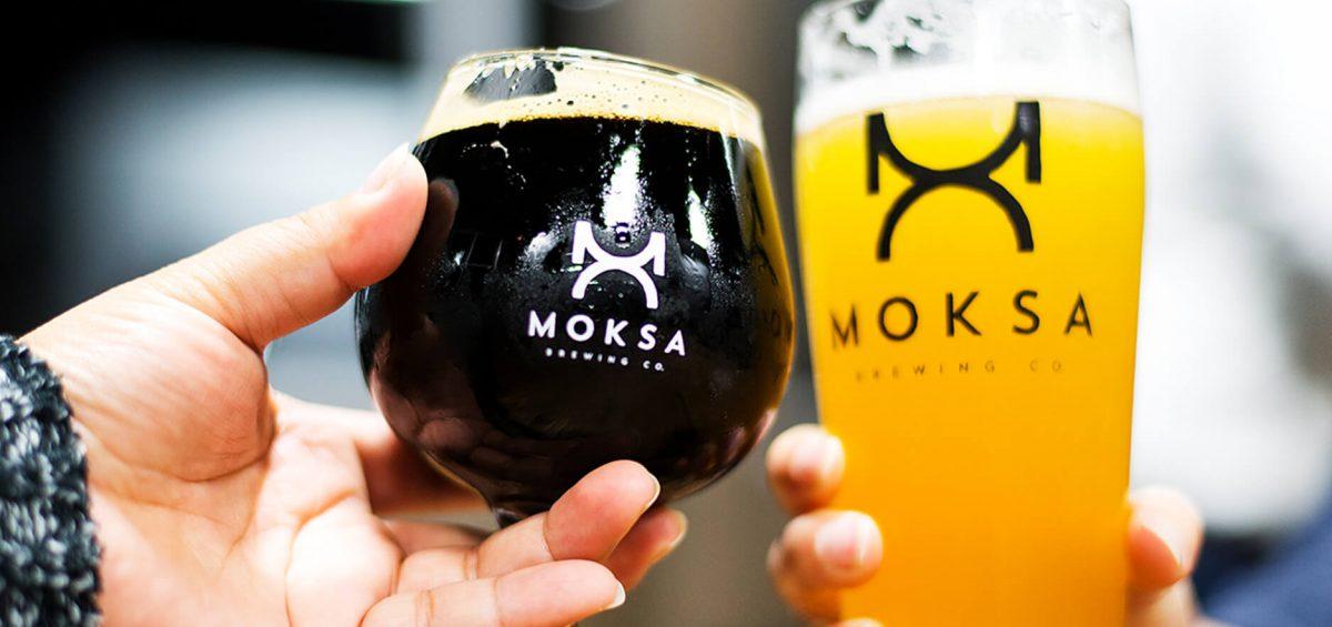 Moksa Brewing Co two glasses cheering
