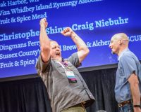 National Homebrew Competition winner celebrating with arms raised
