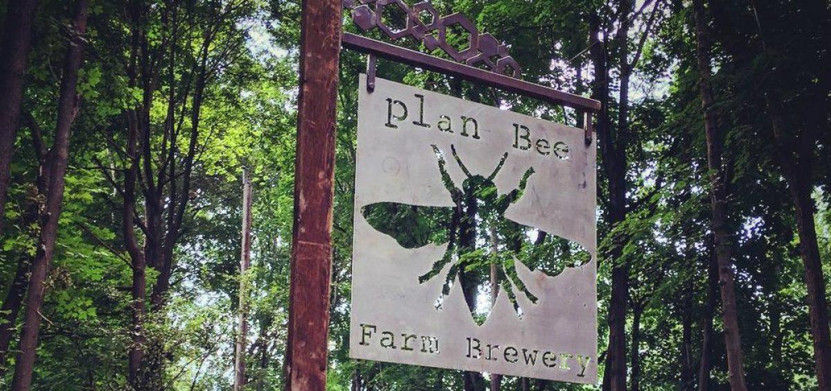 Plan Bee Farm Brewery logo sign on farm