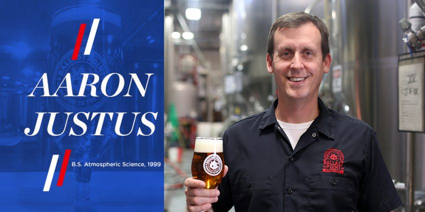 Aaron Justus from Ballast Point Brewing Company with a glass of beer standing in front of stainless fermenters