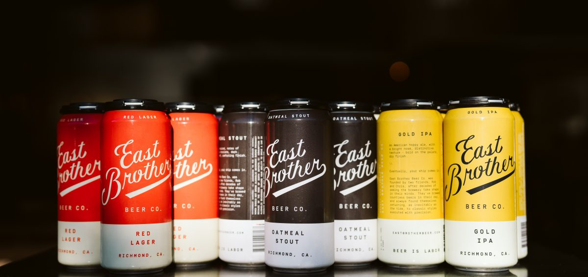 East Brother Beer Company beer in cans on black background